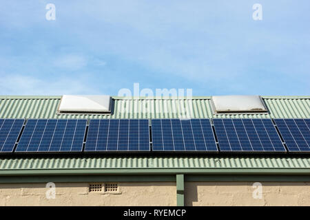 Building solar panels on roof in Victoria, Australia. The photovoltaic cells are an alternative energy, sustainable resource. - Stock Photo