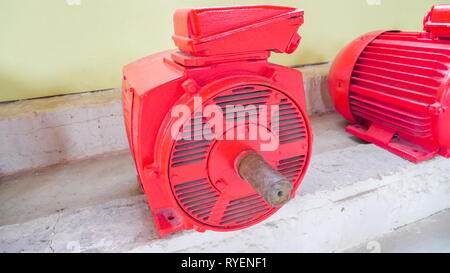 Three red hydropower machine on the side wall of the building