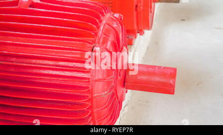 Closer look of the red engine machine on the side in Leevaku Estonia inside the hydropower station in the city