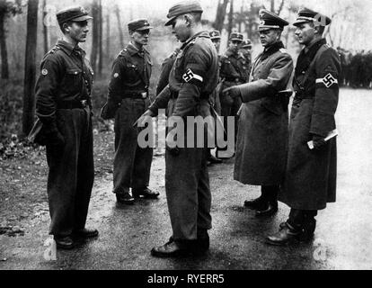 Nazism / National Socialism, organisations, Hitler Youth (HY), Hitler Youth member of the Hitler Youth District Berlin East during paramilitary training, inspection in the presence of an army officer, 1939, Additional-Rights-Clearance-Info-Not-Available - Stock Photo