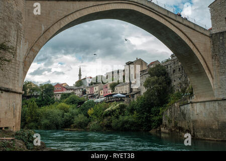 A view of Mostar from beneath the famous Stari Most bridge on a cloudy day, Mostar, Bosnia - Stock Photo