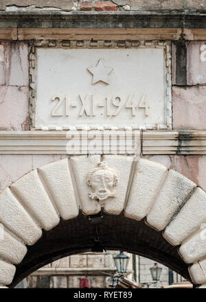 21-XI-1944 inscription on the wall above the old town entrance to Kotor, Montenegro - Stock Photo