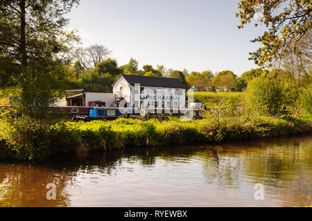 Chirk Marina with narrowboats moored up a boat hire repair fuelling and maintenance centre on the Llangollen canal in Chirk North Wales - Stock Photo