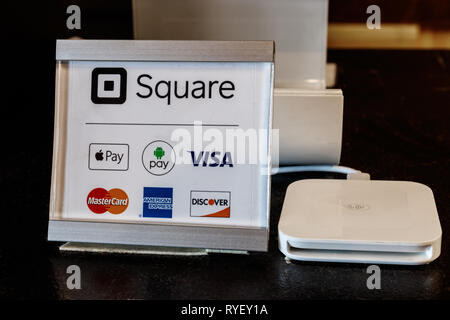 Indianapolis: Circa March 2019: Modern mobile credit methods including Square, Apple Pay, Android Pay, Visa, Master Card, American Express and Discove - Stock Photo