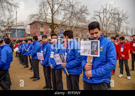 Kashmiri students seen holding placards during a rally marking No Smoking Day in Srinagar. No Smoking Day is observed every year on the second Wednesday of March. - Stock Photo