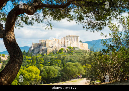Framed view of the Parthenon at the Acropolis viewed from Filopappou Hill in Athens, Greece. Horizontal - Stock Photo