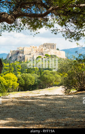Framed view of the Parthenon at the Acropolis viewed from Filopappou Hill in Athens, Greece. Vertical - Stock Photo