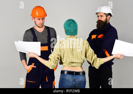 Building your visions. Group of constructing engineers and architects at work. Construction workers team. Professional people working on construction - Stock Photo