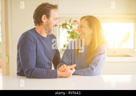 Romantic middle age couple sitting together at home Stock Photo
