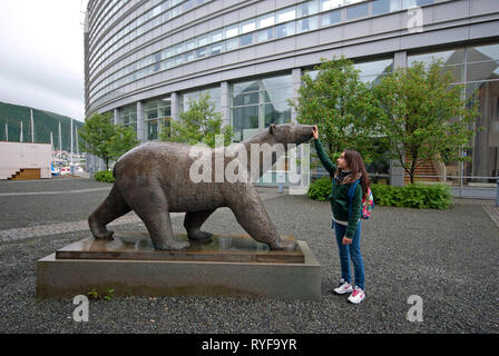 Life-size bronze polar bear statue outside the Polaria Museum in Tromso, Troms County, Norway - Stock Photo