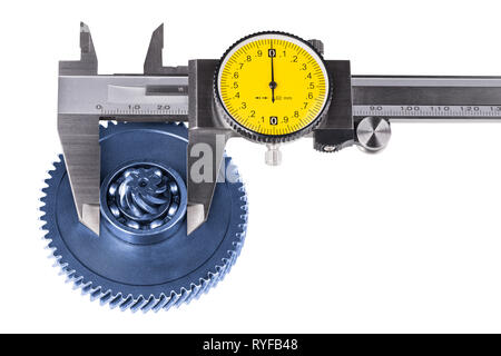 Measurement of cogwheel diameter by caliper. Isolated on white background. Silvery measuring tool. Round yellow dial. Metal gear, ball bearing.Quality. - Stock Photo