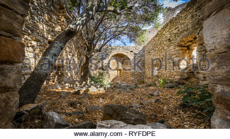 Ruins of a house in Vathia village on the Mani peninsula in the Peloponnese in Greece - Stock Photo