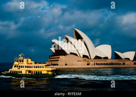 SYDNEY, AUSTRALIA - April 6, 2018: Public ferry in front of the iconic Opera House - Stock Photo