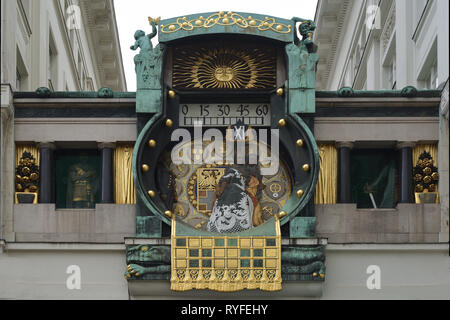 Art Nouveau game clock Ankeruhr from 1914 on the square Hoher Markt in the Austrian capital Vienna - Austria. - Stock Photo