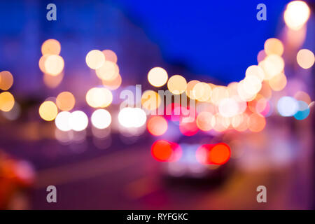 car lights illuminated at night in the big city in blurry style - Stock Photo