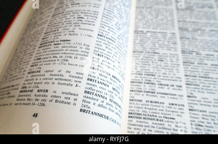 Close up of words on the page of a Childrens Encyclopedia Britannica book - Stock Photo