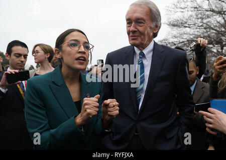 U.S. Rep. Alexandria Ocasio-Cortez, and Senator Ed Markey answers questions during the announcement for the Green New Deal legislation during a press conference outside the Capitol Building February 7, 2019 in Washington, D.C. - Stock Photo