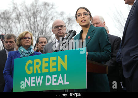 U.S. Rep. Alexandria Ocasio-Cortez of New York, along with other members of Congress announce the Green New Deal legislation during a press conference outside the Capitol Building February 7, 2019 in Washington, D.C. - Stock Photo