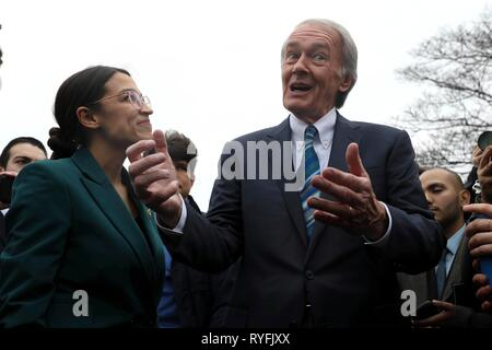 U.S. Senator Ed Markey and Rep. Alexandria Ocasio-Cortez, answers questions during the announcement for the Green New Deal legislation during a press conference outside the Capitol Building February 7, 2019 in Washington, D.C. - Stock Photo