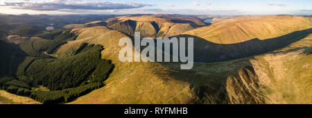 Aerial panorama showing the hills around Talla Reservoir in the Scottish Borders looking North in evening light towards the distant Pentland Hills. - Stock Photo