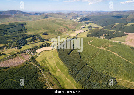 Aerial image showing the Upper Tweed Valley and the village of Tweedsmuir looking north towards the distant Pentland Hills. - Stock Photo