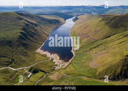 Aerial image of Talla Reservoir looking south towards distant Tinto Hill on a Summer afternoon. - Stock Photo