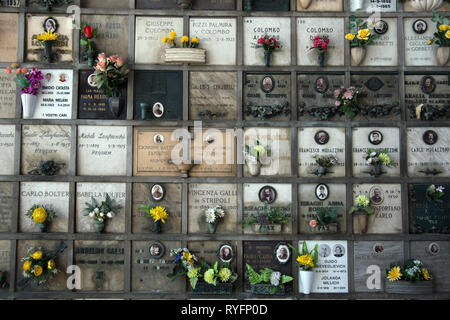 A columbarium wall in the Cimitero Monumentale di Milano, Milan Monumental Cemetery, Milan Italy - Stock Photo
