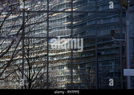 Reflections of the street opposite in the shiny new buildings in the Porta Nuova district, Milan Italy - Stock Photo