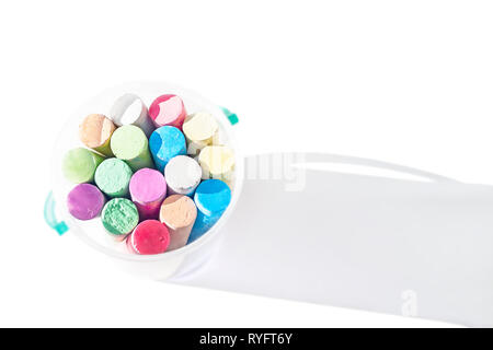 Pack of Jumbo Sidewalk Chalk, Assorted Colors in a Plastic Bucket on White Background with Shadow. Top View. - Stock Photo