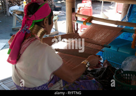 Chiang Rai Thailand, woman from the Karen long neck tribe working in village tourist market - Stock Photo