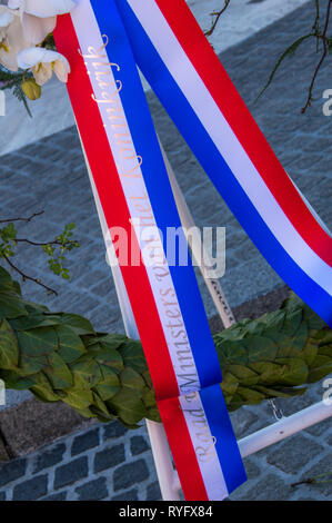 Ribbon On The Flowers At The Remembrance Of The Dead Statue At Amsterdam The Netherlands 2018 - Stock Photo