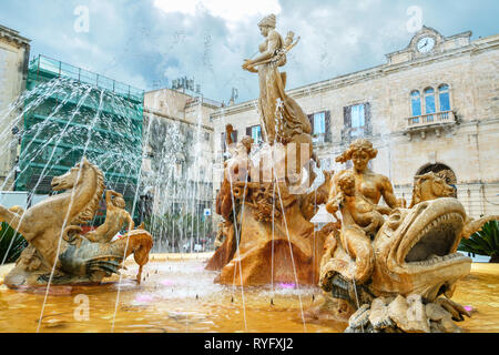 View to Fountain of Diana (Fontana di Diana) on Archimedes Square (Piazza Archimede) in Ortigia island. Syracuse, Sicily, Italy - Stock Photo