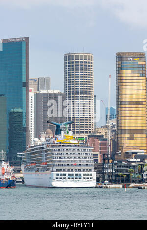 Carnival legend cruise ship moored at Circular Quay and view of Sydney office centre and high rise buildings,Sydney,Australia - Stock Photo