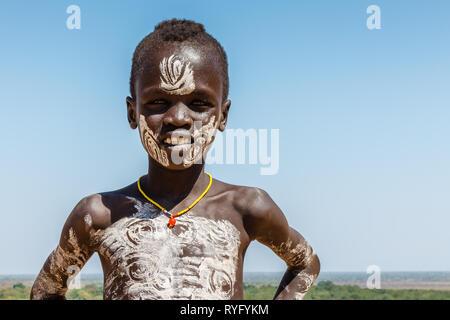 Omo Valley, Korcho village, Ethiopia - December 09, 2013: Unidentified Karo boy near the Korcho village in the Omo Valley. - Stock Photo