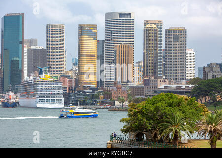 Sydney Circular Quay, Cruise ship Carnival legend, Manly fast ferry and Sydney city centre,New South Wales,Australia - Stock Photo