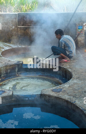 HIMACHAL PRADESH, INDIA. The juice of the sugar cane plant is transfomed to crystalline cane sugar by boiling - Stock Photo