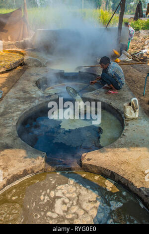 HIMACHAL PRADESH, INDIA. 10-29-2015. The juice of the sugar cane plant is transfomed to crystalline cane sugar by boiling - Stock Photo