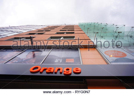 Poznan, Poland - March 8, 2019: Orange shop logo on the Globis office building. - Stock Photo