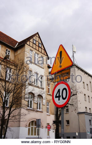 Poznan, Poland - March 8, 2019: Speed limit sign showing number forty on the Slowackiego street with apartment buildings. - Stock Photo