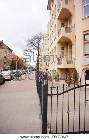 Poznan, Poland - March 8, 2019: Metal fence in front of a apartment building on the Slowackiego street. - Stock Photo