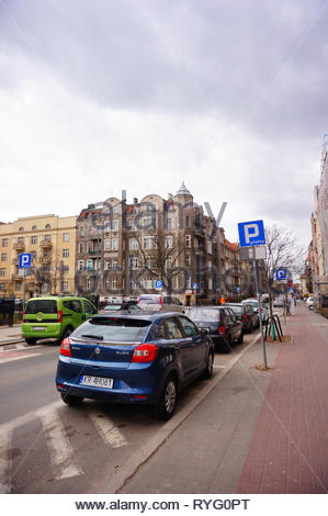 Poznan, Poland - March 8, 2019: Parked new blue Suzuki Baleno car on a non parking area on the Slowackiego street in the city center. - Stock Photo