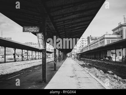 Black and white photo of  abandoned main train station in Belgrade, geometry of lines and shadows - Stock Photo