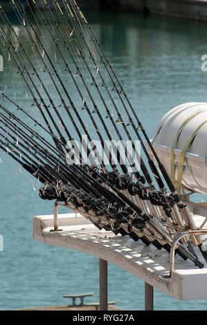 Fishing rods on a boat moored in Brighton Marina, Sussex, England. - Stock Photo