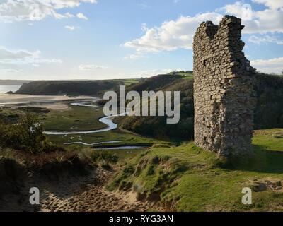 Pennard castle ruins overlooking Three Cliffs Bays and meandering Pennard Pill stream, Parkmill, The Gower peninsula, Wales, UK, October 2018. - Stock Photo