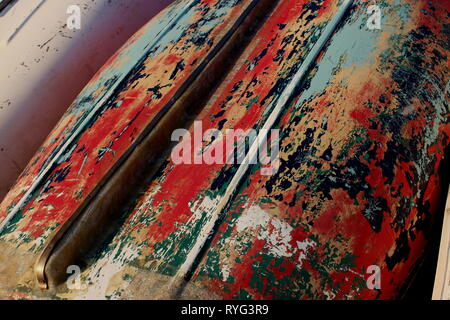 an abstract colour image showing the underside of a boat hull that has been prepared ready for painting leaving various colourful patterns - Stock Photo