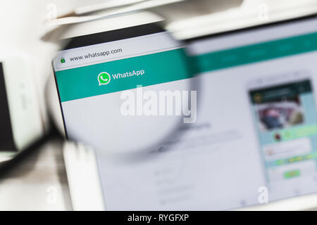 San Francisco, California, USA - 14 March 2019: WhatsApp Messenger, social official website homepage under magnifying glass. Concept WhatsApp, social - Stock Photo