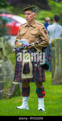Woodhall Spa 1940s Festival - Scottish soldier piper with bagpipes at Remembrance Service at the start of the festival - Stock Photo