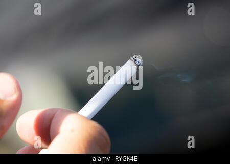 man smoking a cigarette cancer caucasian close up copy - Stock Photo