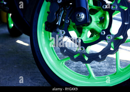 Photo of a disc brake on the front tire of a motorcycle - Stock Photo