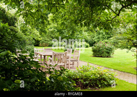 Dining area on patio in grounds - Stock Photo